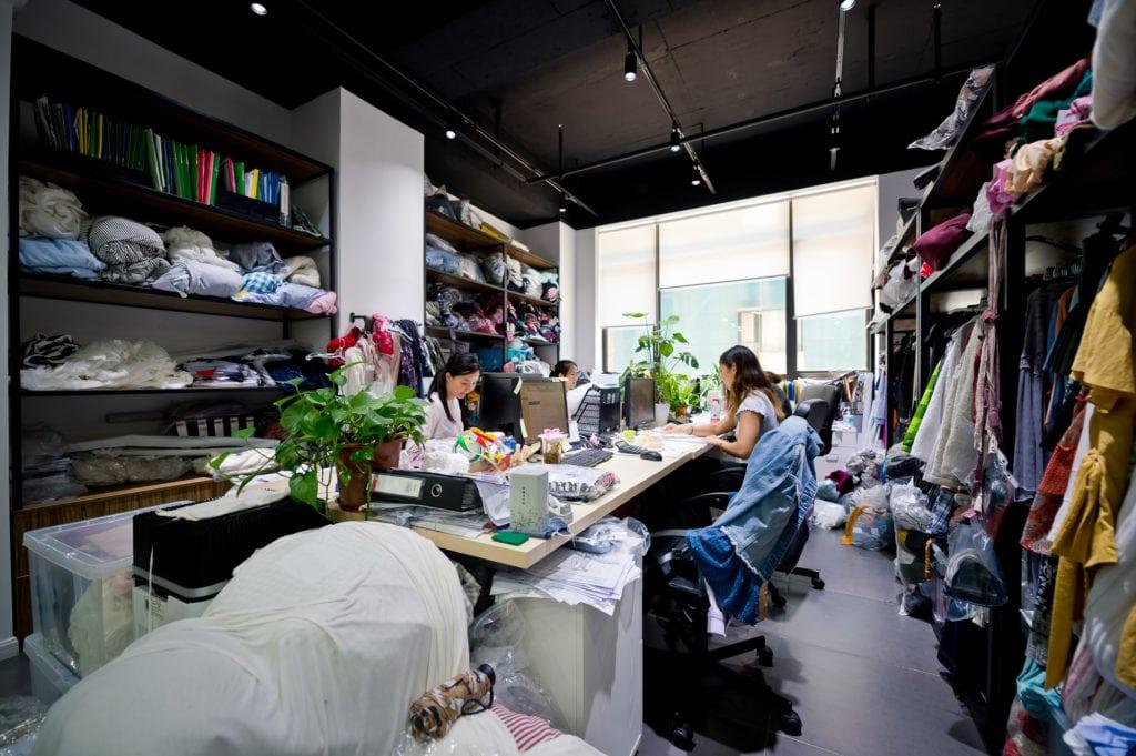 Astra working at her fashion internship in Shanghai